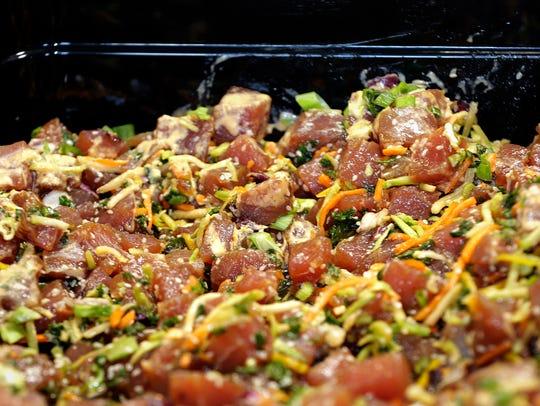 Poké with raw ahi tuna was part of a Hawaiian buffet