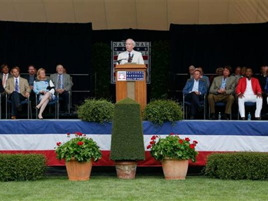 Tom Gage speaks after receiving the J.G. Taylor Spink Award during a ceremony at Doubleday Field on Saturday, July 25, 2015, in Cooperstown, N.Y.