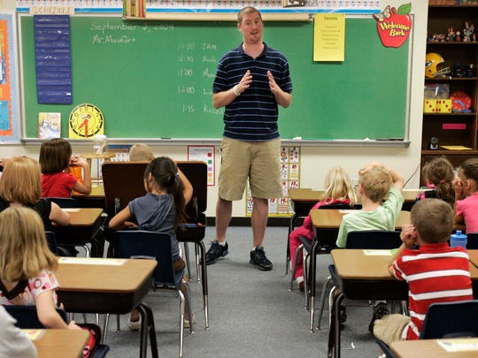 Steve Maufort talks to his second-grade students on