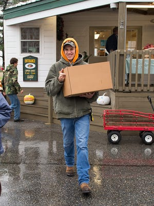 Fifer Orchards' Jimmy Joiner carries out a customer's Thanksgiving turkey Wednesday.