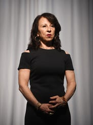 Emmy winning journalist Maria Hinojosa listens to a