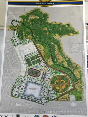 An artist's rendering of the proposed Wildcreek Project is seen during a press conference at Procter Hug High School in Reno on April 26, 2017.