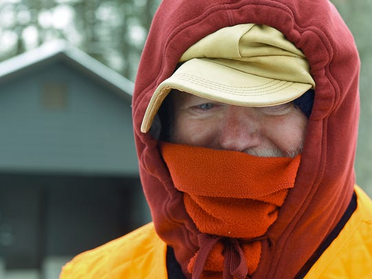 In this file photo, Joe Carolin of Fayetteville was bundled up for a walk on a frigid February day in 2016.