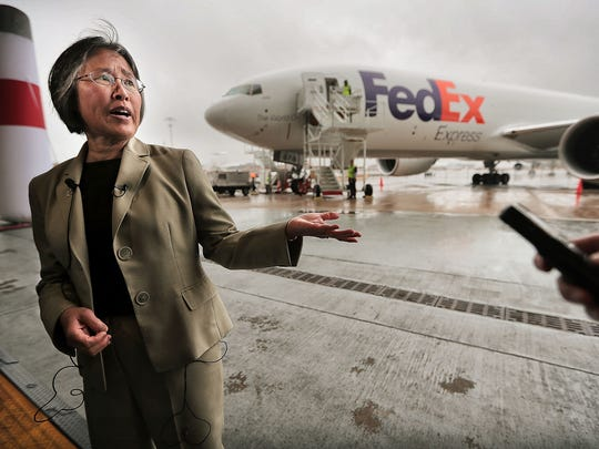 """Boeing's Director of Technology Integration Jeanne Yu talks with media about """"The ecoDemonstrator"""", a Boeing 777 FedEx transport plane that has been modified to test new fuel and safety technology, which was on display at the FedEx hub in celebration of Earth Day."""