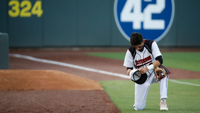 Jefferson shortstop Mike Cortez prays before the start of the game against the Bowie Bears on Tuesday night at Southwest University Park.