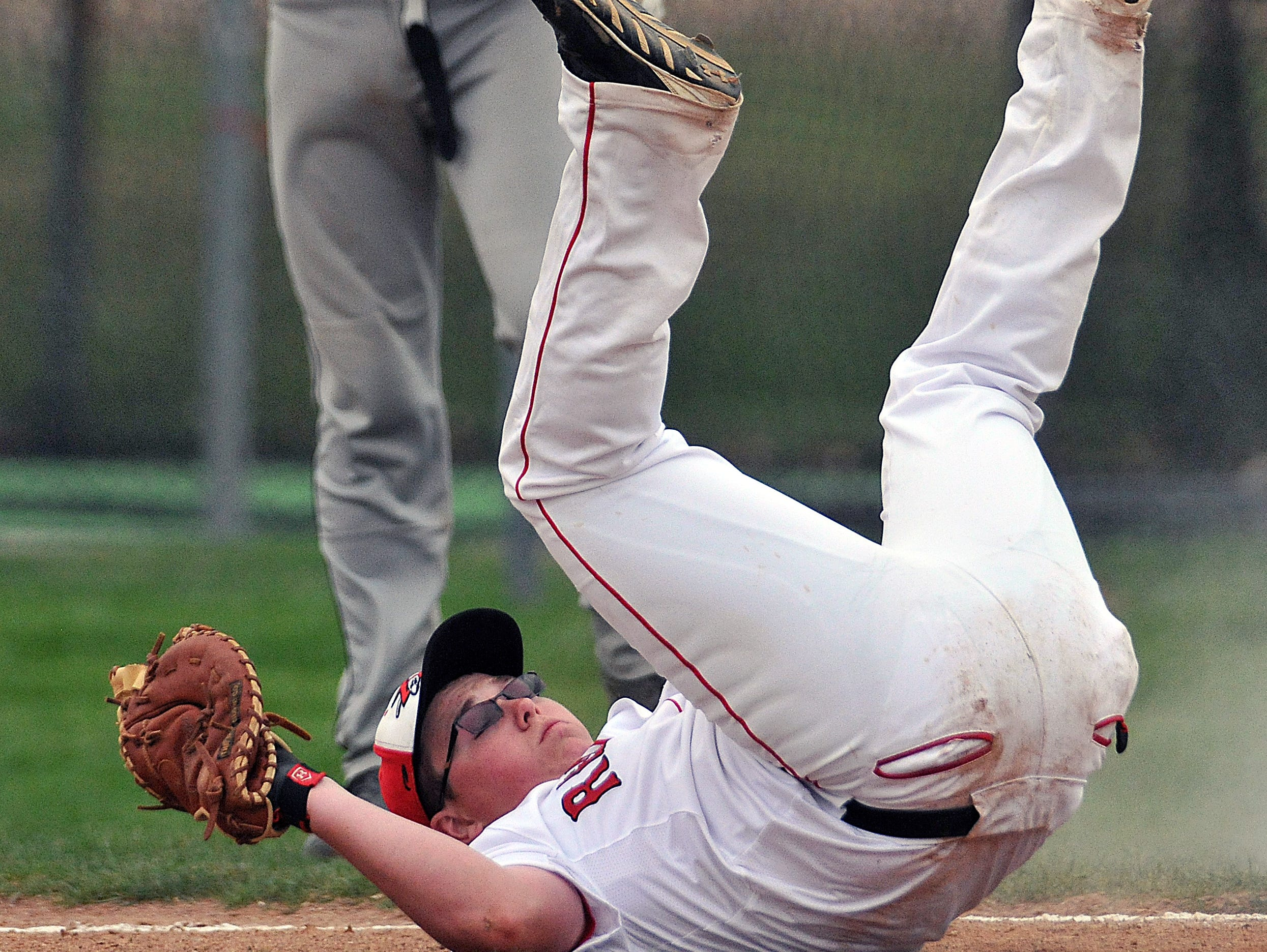 Bucyrus' Nick Kohler comes down after making a play at first base during a game Thursday against Colonel Crawford.