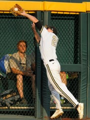 Vanderbilt outfielder Bryan Reynolds (20) catches a fly ball hit by Louisville's Grant Kay in the second inning Saturday.