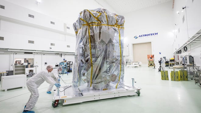 NASA's Parker Solar Probe is wheeled into position in a clean room at Astrotech Space Operations in Titusville for pre-launch testing and preparations.