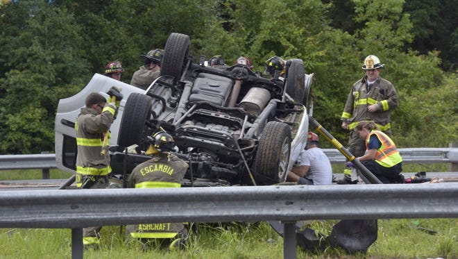 Escambia County Fire Rescue responds Thursday, May 31, 2018, to the scene of a single-vehicle rollover off I-10.