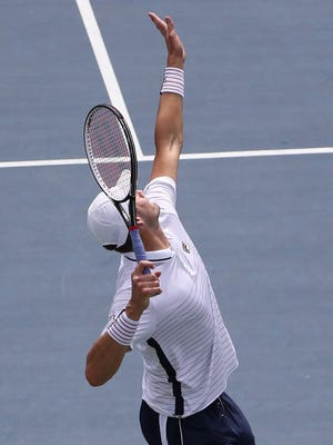 John Isner of the United States serves to Steve Darcis of Belgium during the 2016 U.S. Open at USTA Billie Jean King National Tennis Center on Aug. 31.