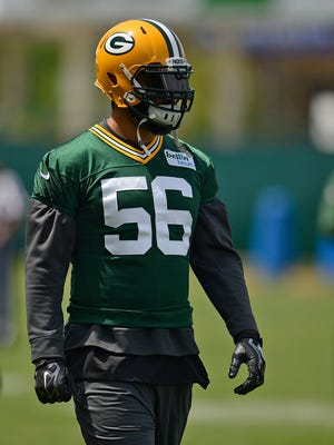 Green Bay Packers linebacker Julius Peppers looks on during organized team activities June 2 at Clarke Hinkle Field.
