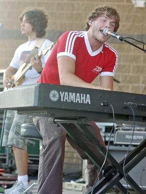 Jon McLaughlin performs as the opening act of Waterfest Thursday night at the Leach Amphitheater. Northwestern photo by Laura May