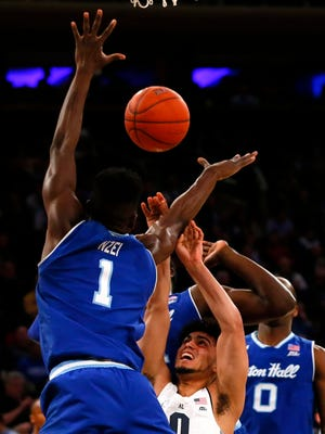 Marquette guard Markus Howard is surrounded by Seton Hall defenders Thursday during a Big East quarterfinal at Madison Square Garden.