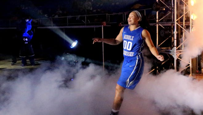 Former Blackman player and first time MTSU player Alex Johnson is the first of the basketball players to enter the arena during MTSU's Murphy Madness, on Thursday Oct 29, 2015.