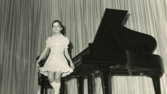 Pianist Nada Loutfi at a piano recital as a child.
