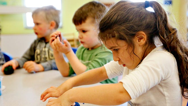 Three-year-old students, from front, Sophia Brands, Liam Benica, and Grant Rexroth form Play-Doh into Earth Day-themed shapes at the The Goddard School, Thursday, April 21, 2016. Dawn J. Sagert photo