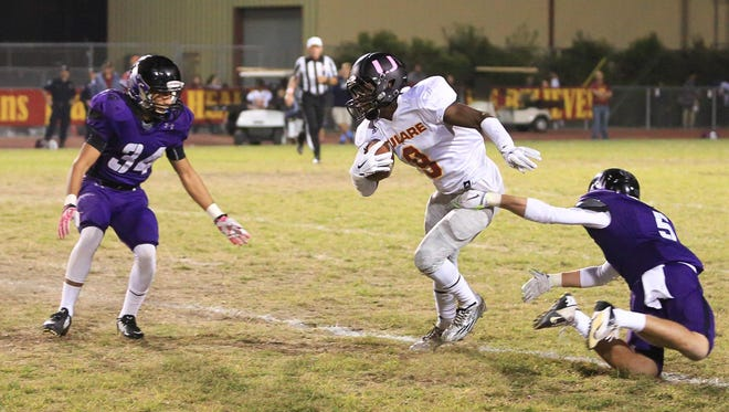 Tulare Union's Emoryie Edwards, 9, splits a pair of Mission Oak defenders in last season's meeting. The Tribe won 55-41 in 2015.