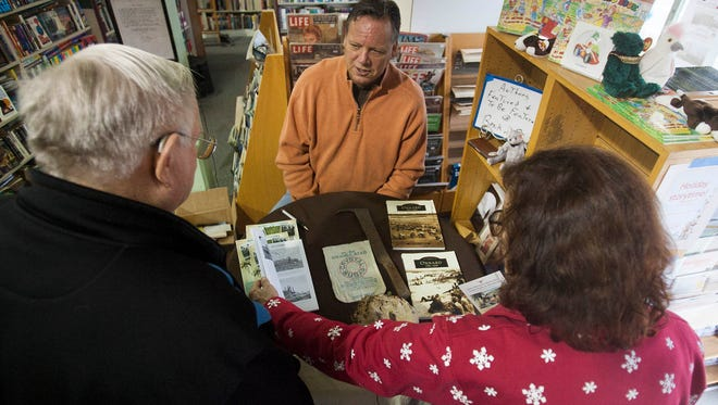 "Jeff Maulhardt, center, talks recently to Geoffrey Lillich, left, and Marsha Craig about his new book, ""Oxnard Sugar Beets"" at Bank of Books in Ventura."