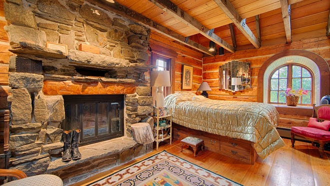 The bedroom of a home for sale at 112 Sun Meadows Road includes rustic finishing touches.