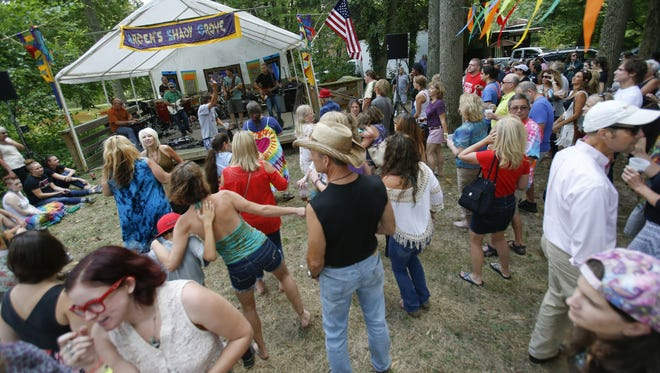 Jam band Montana Wildaxe gets the crowd dancing in the Shady Grove during the 109th Arden Fair last year.