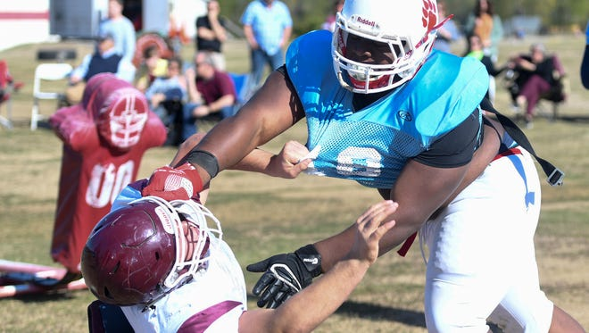 University School of Jackson offensive lineman Mario Nicholson goes against a Hardin County lineman in a spring football practice and scrimmage, Friday, April 20 at USJ.