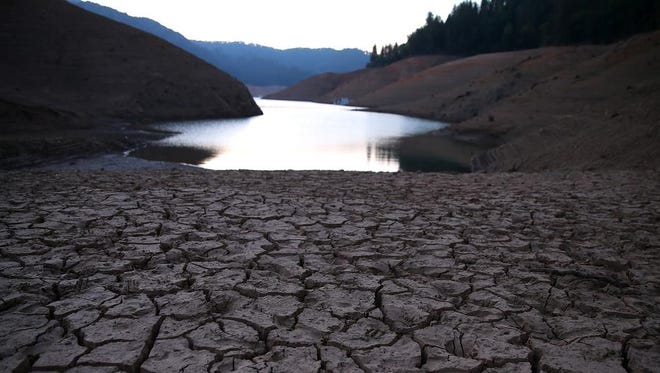 Dry, cracked earth is visible on the banks of Shasta Lake at Bailey Cove on August 31, 2014, in Lakehead, California.