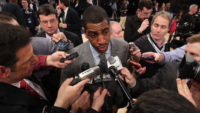Connecticut Huskies coach Kevin Ollie talks to reporters after beating Michigan State.