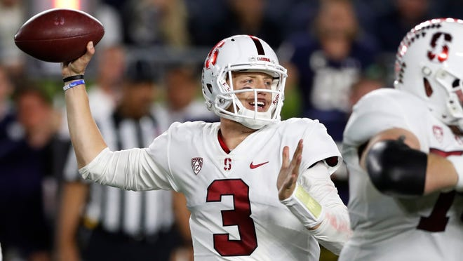 Stanford quarterback K.J. Costello throws during the first half of the team's NCAA college football game against Notre Dame, Saturday, Sept. 29, 2018, in South Bend, Ind. (AP Photo/Carlos Osorio)