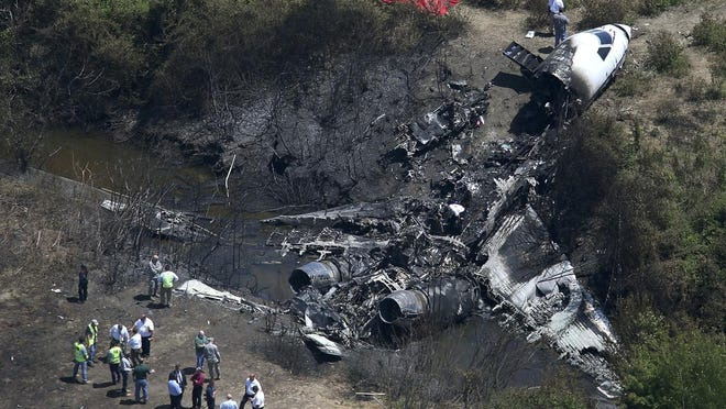 The wreckage of Cherry Hill philanthropist Lewis Katz's private jet, which crashed during a takeoff attempt on May 31, 2014, in Bedford, Massachusetts.