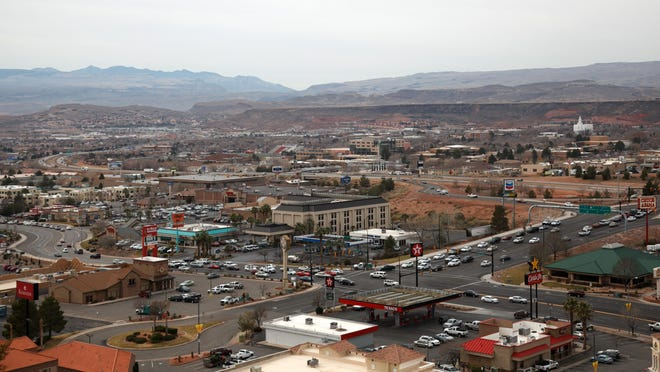 Traffic flows along Interstate 15 in the background and through the intersection where Mall Drive and River Road meet with St. George Boulevard.
