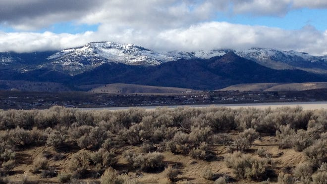 A file photo showing snow capped mountains seen from north Reno. Local forecasters expect a storm to drop rain and up to 12 inches of snow in some areas of the Sierra Crest over the weekend. A winter weather advisory was issued through Friday morning.