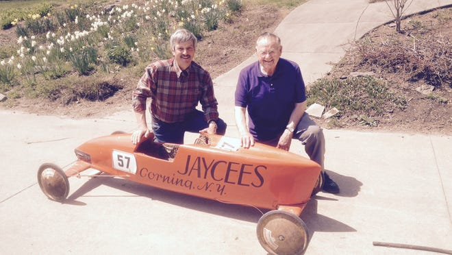 Jack Littleton, left, who won Corning's Second Soap Box Derby competition in 1966, shows off his winning car with Frank Hamm, who was director of the first two events.