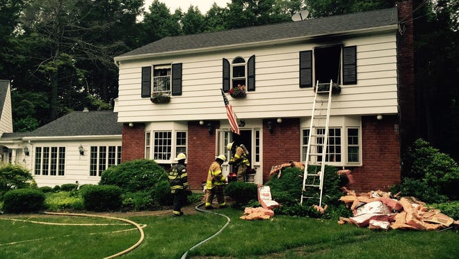 Firefighters at the scene of a fire at 15 JoAnn Place in Philipstown, June 16, 2015.
