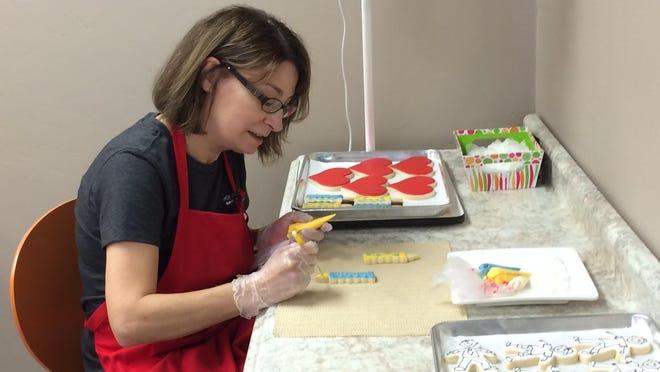 Funky Cookie Studio owner Jill Wettstein spends her days decorating cookies in her Sister Bay shop.