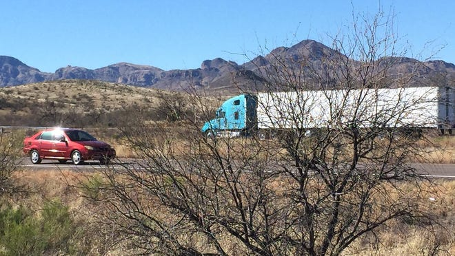 A semitruck travels on Interstate 19 north of Nogales, Ariz. An estimated 387,000 truckloads passed through the Arizona border town in 2013.