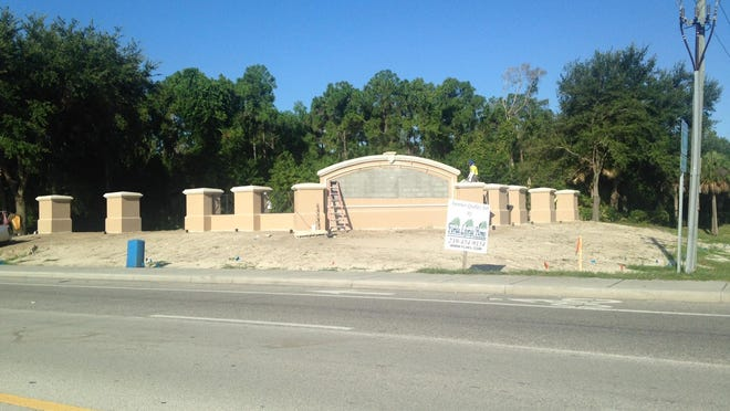 The entrance to Three Oaks in Estero is being rebuilt after being demolished in a road project on on Three Oaks Parkway.