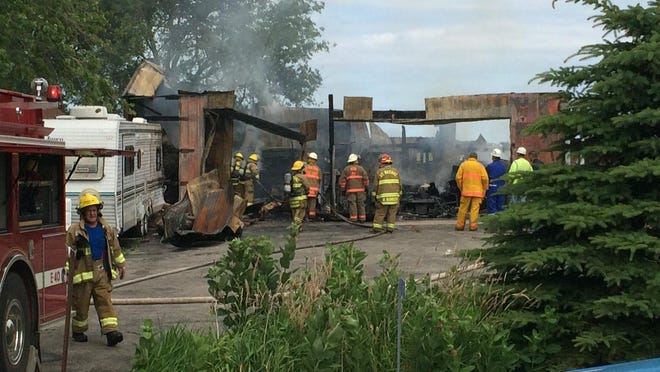 A garage at 8715 Hwy. 42 in Newton is a total loss following a fire July 7.