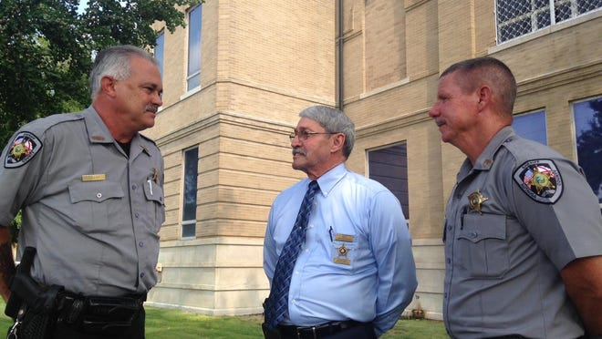 From left, Dep. Jeff Bert, Sheriff Joe Sedinger and Sgt. Steve Adams talk Friday morning in front of the Autauga County Courthouse.