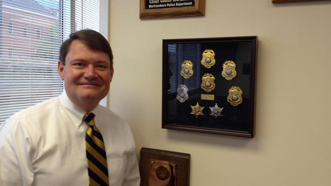 Murfreesboro Police Chief Glenn Chrisman displays the many badges he's worn, including two deputy badges, police officer, sergeant, lieutenant, captain, deputy chief and chief.