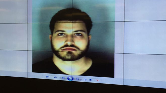 A mugshot of Benjamin Rauf is shown at New Castle Police Department headquarters.