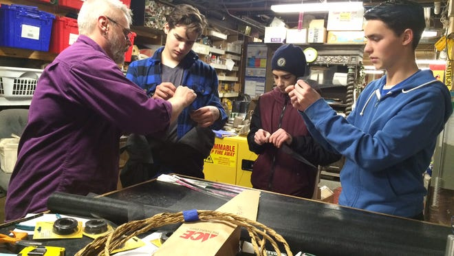 Prop Shop Manager Mark Bissonnette works with SOTA Students.