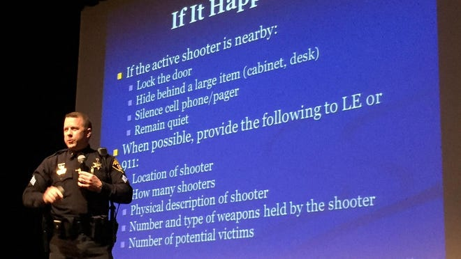 """Monroe County Sheriff's Office Sgt. Brian Wicks speaks during an """"active shooter"""" seminar hosted by the Greater Rochester Chamber of Commerce on March 9, 2016."""