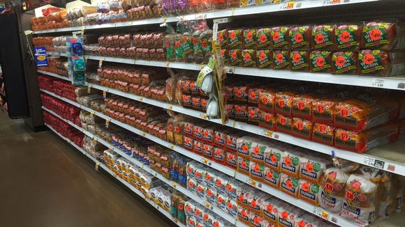 By 7 a.m., the Kroger at Poplar Plaza had already restocked the essentials -- bread and milk.