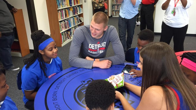 Henry Ellenson was at Flint Doyle/Ryder Elementary on Wednesday for the opening of the school's renovated library. The Pistons aided the renovation.