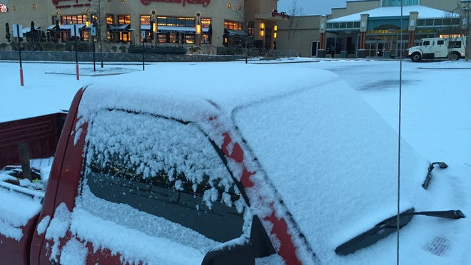 Snow covers a vehicle outside the Cheesecake Factory at West Town Mall on Wednesday, Jan. 20, 2016. (MICHAEL PATRICK/NEWS SENTINEL)