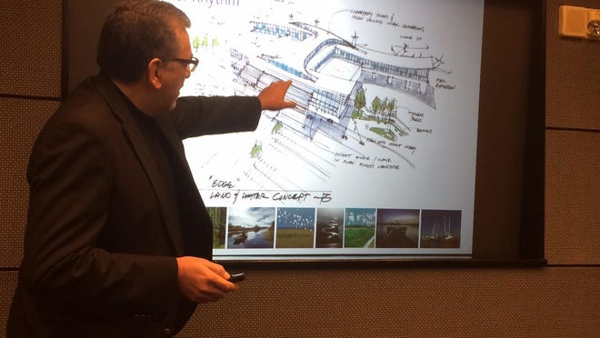 Frank Gratton, a designer involved in creating the new terminal for the Lafayette Regional Airport, discusses one of the proposed designs at the Lafayette Regional Airport Commission meeting Thursday.