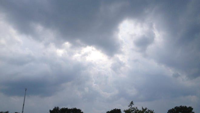 Storm clouds gather over East Central Indiana.