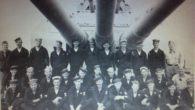 Seaman 2nd Class William Ault is pictured with some of his fellow Navy crew members aboard the USS Indianapolis. Ault is in the second row, fifth from left.