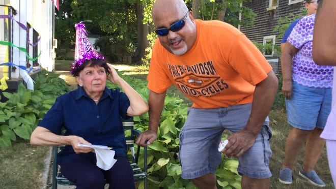 Recently widowed, Irene Gomes' family and friends held a surprise birthday party for her Tuesday to cheer her up. She is pictured here with her son Gary.