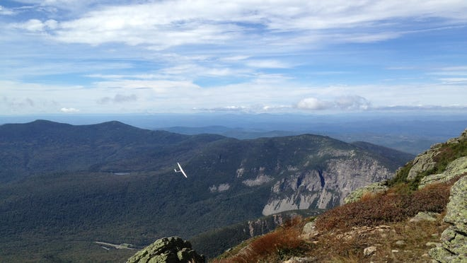 A glider soars near Franconia Ridge in the White Mountains of New Hampshire.
